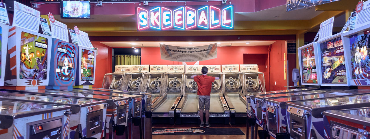 Text Illuminated Indoors  Store Food And Drink Communication No People Western Script Built Structure Table Railing Arts Culture And Entertainment Neon Retail  Representation Large Group Of Objects Technology Absence Skeeball Arcade