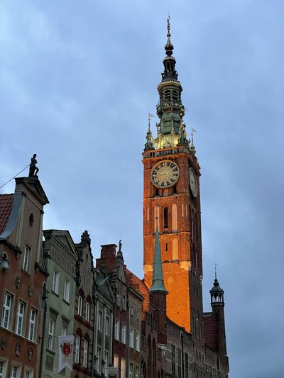 Low angle view of clock tower in city against sky