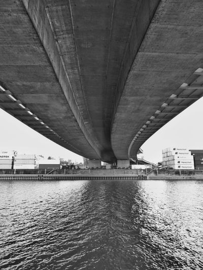Bridge - Man Made Structure Connection Architecture Built Structure River Transportation Water Outdoors Underneath City Industrial Photography Perspectivephotography Perspektive Perspectives And Dimensions Perspective Photography Quiet Places Industrial Landscapes Container Construction Site Wanderlust Building Exterior Perspektif Perspectives Perspective Tranquility The Street Photographer - 2017 EyeEm Awards