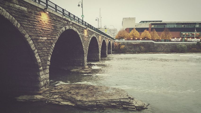 Genesee River Flowing Under the Bridge Downtown   Rochester, NY Gloomy Gloomy Day Gloomy Weather River Riverwalk Flowing Water Nature And City Wide Reflection Bridge Water Reflections Water Cityscapes Tunnel New York I Love New York Rochester Rochester, NY Nature Genesee