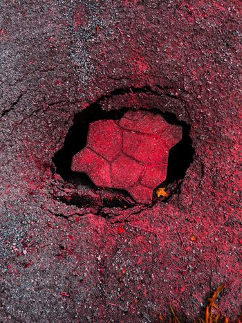 Backgrounds Black Color Close-up Day Dirty Elevated View Full Frame Ground Hole Nature No People Outdoors Overhead View Pink Color Red