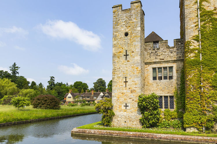 Hever Castle and Moat, Hever Castle & Gardens, Hever, Edenbridge, Kent, England, United Kingdom Architecture Beauty In Nature Building Exterior Built Structure Castle Cloud - Sky Day History Nature No People Outdoors Scenics Sky Tranquility Travel Destinations Tree Water