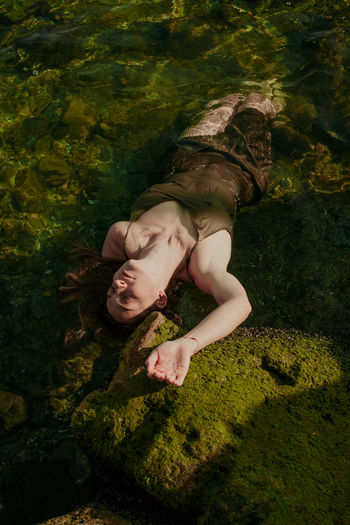 High angle view of woman relaxing on land