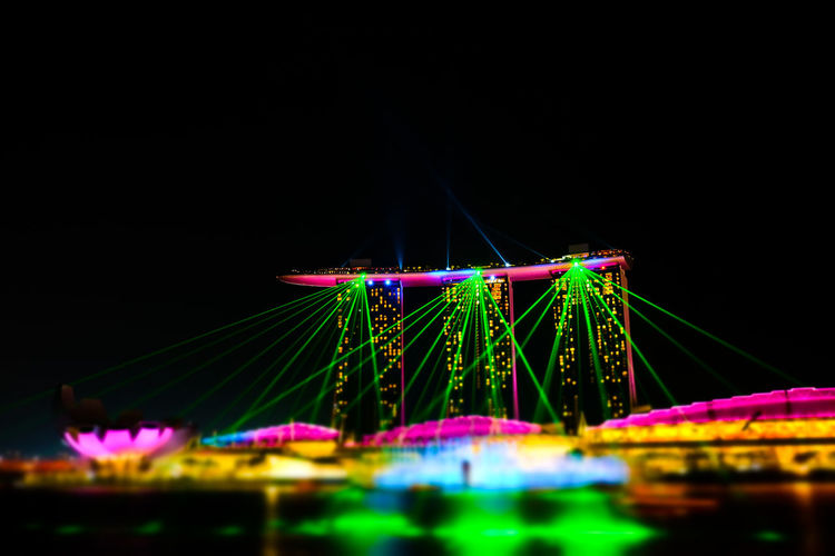 Singapore by night Singapore Amusement Park Amusement Park Ride Architecture Arts Culture And Entertainment Built Structure Clear Sky Copy Space Ferris Wheel Illuminated Lasershow Lightshows Marinabaysands Multi Colored Night No People Outdoors Singaporebynight Sky Travel Destinations Water