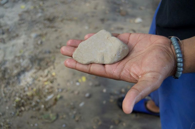 Human Hand One Person Real People Human Body Part Holding High Angle View Outdoors Day Close-up Men Freshness Adult People 2017 Rocks Nature The Great Outdoors - 2017 EyeEm Awards Tranquility Beauty In Nature Lake Sand Water