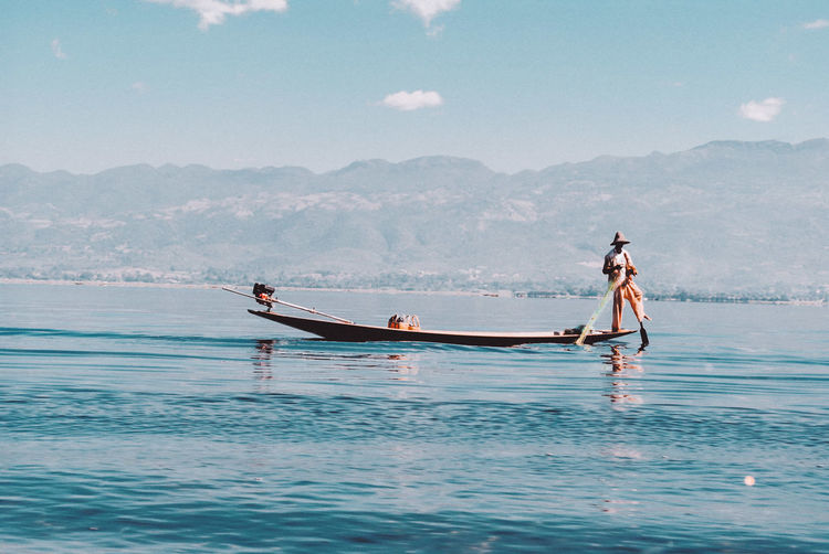 #Inle Lake #Myanmar #Myanmar #travel #Fisherman Water Sea Beauty In Nature Real People Leisure Activity Full Length Mountain Day Nature Sky