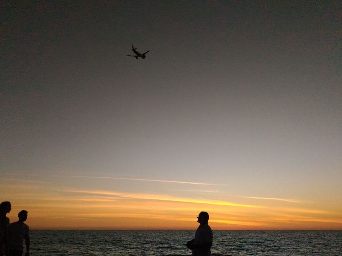 Silhouette Sea Sky Sunset Beach Flying Nature Scenics Travel Destinations No Edit/no Filter People Airplane Shot Wanderlust Nomadic Sunset Sky Sand & Sea Orange Sky Sky And Sea Jetplane Seascape Photography Phuket,Thailand