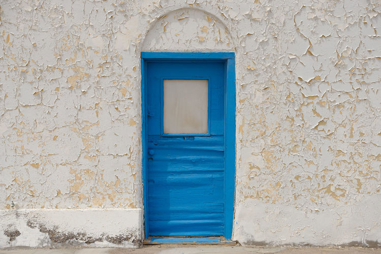 Blue door and white wall at the Amargosa Opera House in the California Desert Arched Doorway California Dreamin Entrance Architecture Blue Building Exterior Door Entrance No People Opera House Peeling Paint Wall