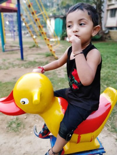 Spring Ride EyeEm Selects Childhood Child One Girl Only One Person Fun Girls People Children Only Yellow Smiling Happiness Portrait Amusement Park Outdoors Day Full Length