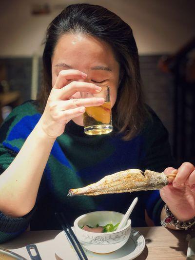 Woman Having Food At Table