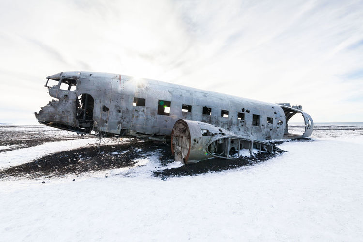 Abandoned airplane on snow covered land