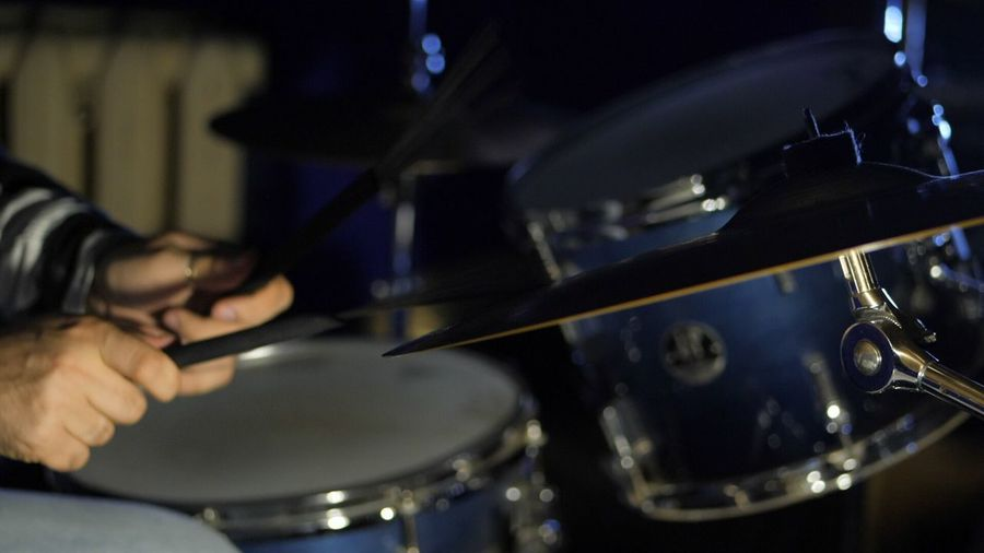 Cropped Image Of Drummer Playing Drums