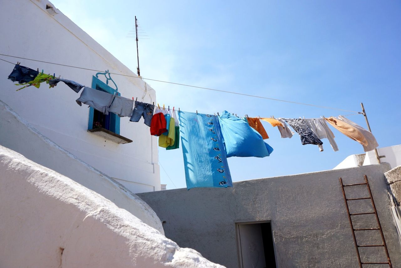 Low angle view of clothing on clothesline at building