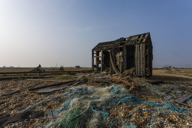 Fishing Shack at Dungeness, Romney Marsh, England, United Kingdom Abandoned Architecture Building Exterior Built Structure Clear Sky Damaged Day Desolate Field Landscape Nature No People Outdoors Sky Wood - Material