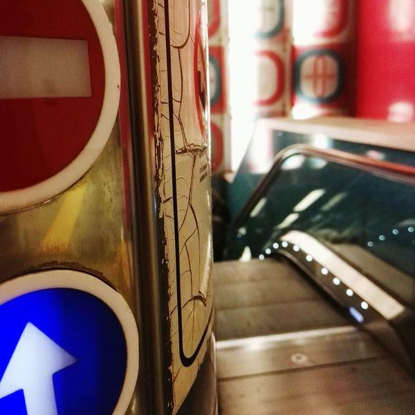 Should I stay or should I go Underground Escalator Station Directional Sign Close-up Arrow Sign One Way Subway Station Subway