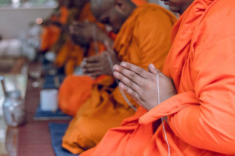 Belief Day Group Of People Men Orange Orange Color Real People Religion Spirituality