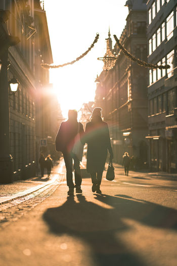 bright daylight in Stockholm Emotions Christmas Lights Christmas Decoration Silhouette Sillouette Human Together Romance Shadows & Lights Sunlight Adult Architecture Building Exterior Built_Structure City City Life Full Length Lifestyles Men Outdoors People Real People Rear View Shadow Street Walking Women Fresh On Market 2018