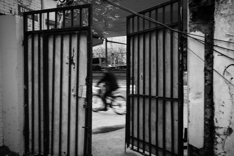 Architecture Built Structure Blurred Motion Motion Building Exterior City Real People One Person Street Walking Building Full Length Day Transportation Mode Of Transportation City Life Outdoors Road Adult Iron Streetphotography Balck And White Blackandwhite