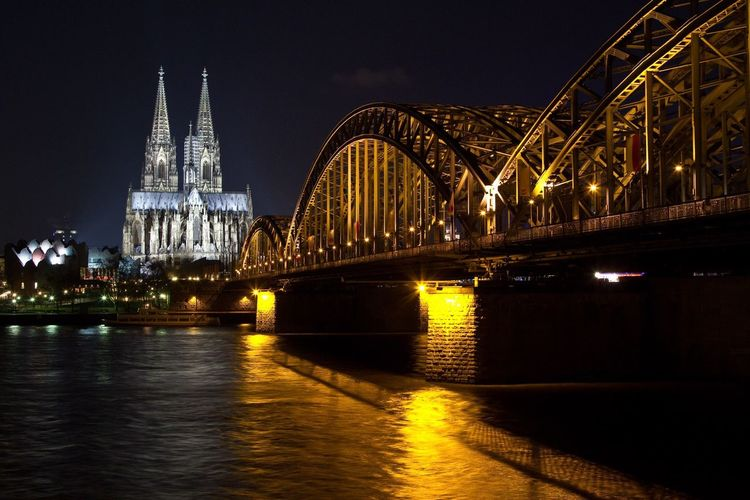 Illuminated Built Structure Connection Architecture Bridge - Man Made Structure River Night Transportation Engineering Water Arch Waterfront Arch Bridge Travel Destinations Building Exterior Tourism Travel Famous Place Reflection Bridge Köln Dom Cologne Germany