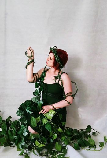 Young Woman Standing In Plants