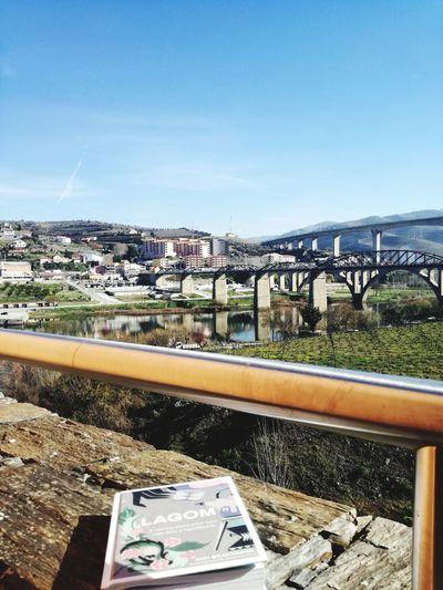 Paisagem relaxante para ler! Bridge Book Lagom Livro  Portugal Portugaldenorteasul Lamego City Water Clear Sky Sea Cityscape Sky Architecture Building Exterior Built Structure