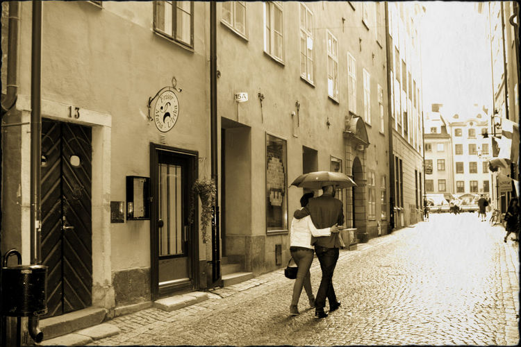Walking couple in the rain Architecture City Couple - Relationship Day People Raining Rainy Days Real People Stockholm Walking
