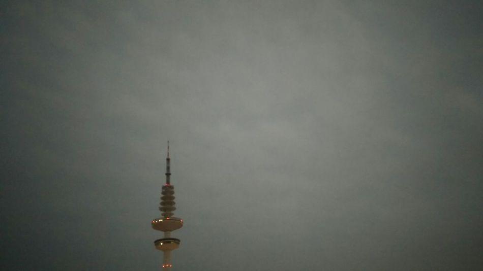 Heinrich-Hertz-Turm Hamburg. · Germany Hh 040 Messeturm Radio Tower Tower Landmark Architecture Iconic Urban Landscape Lights Dusk Nightfall Gray Sky Cloudy Day Clouds And Sky Light Pollution