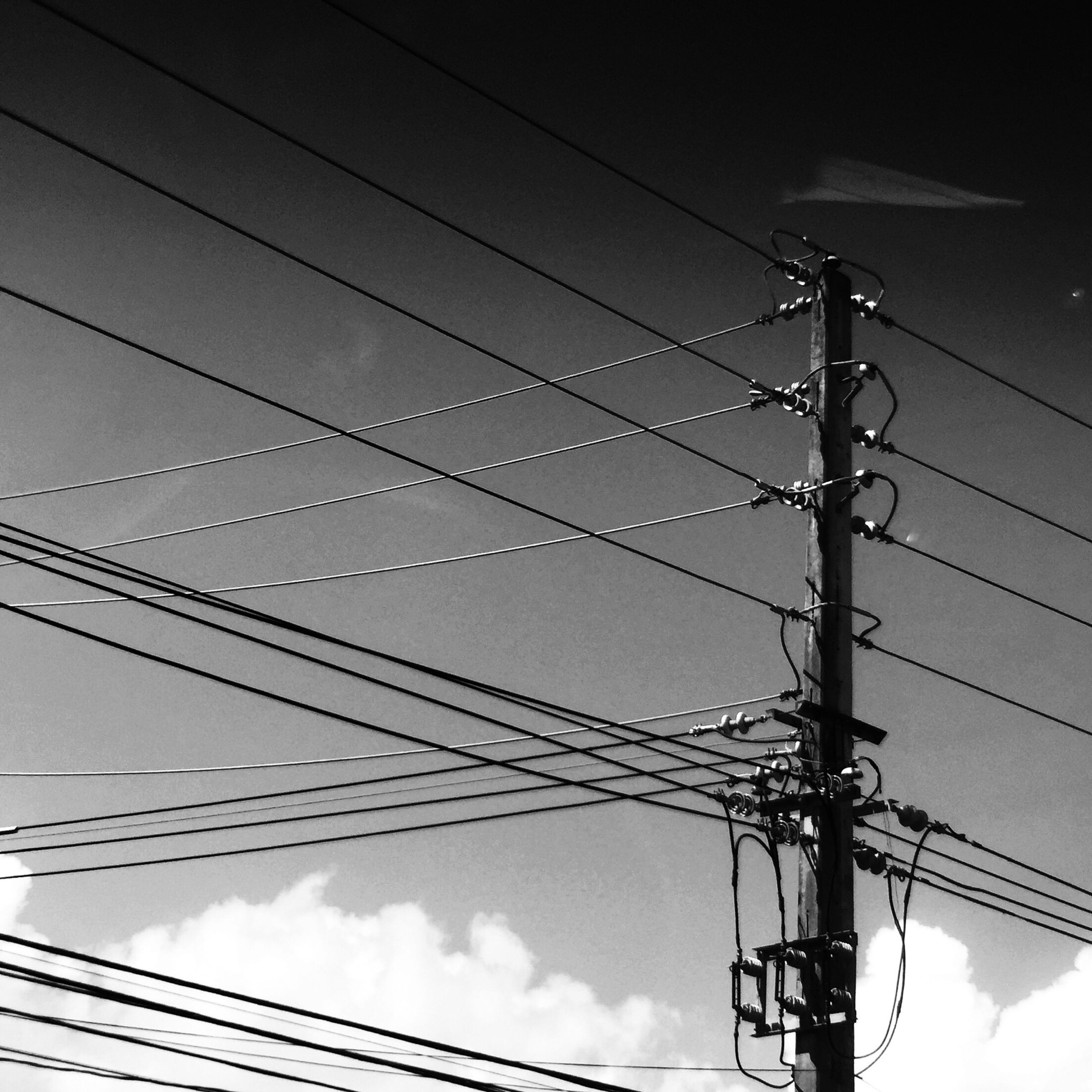 power line, low angle view, electricity, power supply, electricity pylon, connection, cable, fuel and power generation, sky, technology, power cable, silhouette, cloud - sky, complexity, cloudy, outdoors, no people, cloud, telephone pole, pole