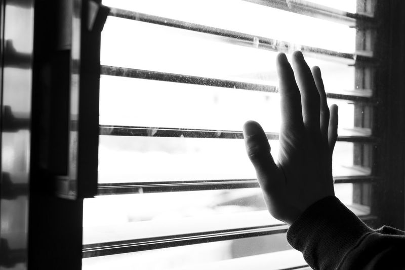 Close-up of hand holding window