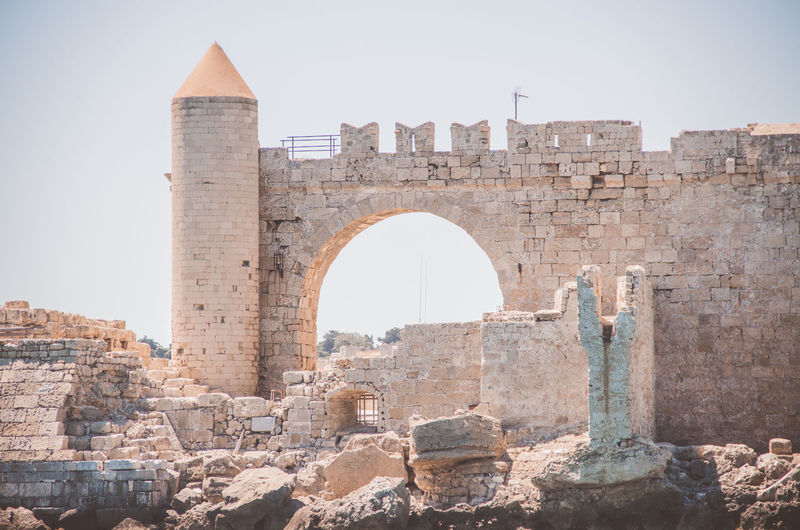 Architecture History The Past Built Structure Ancient Building Exterior Old Old Ruin Sky Clear Sky Travel Destinations Nature Day Fort Wall Travel Tourism Building No People Stone Wall Ancient Civilization Ruined Outdoors Deterioration Rhodos, Greece