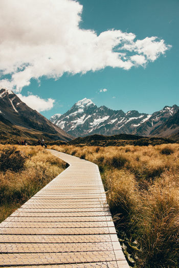 Mount Cook National Park, New Zealand Mountain Sky Beauty In Nature Landscape Environment Footpath Tranquility Tranquil Scene Scenics - Nature Nature Cloud - Sky Direction Plant The Way Forward Non-urban Scene Mountain Range Day No People Outdoors Idyllic