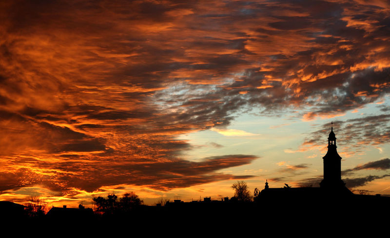The Sky is on Fire #church #cloud #evening #Poland Architecture Building Exterior City Cityscape Cloud - Sky Dramatic Sky No People Outdoors Scenics Silhouette Sky Sunset