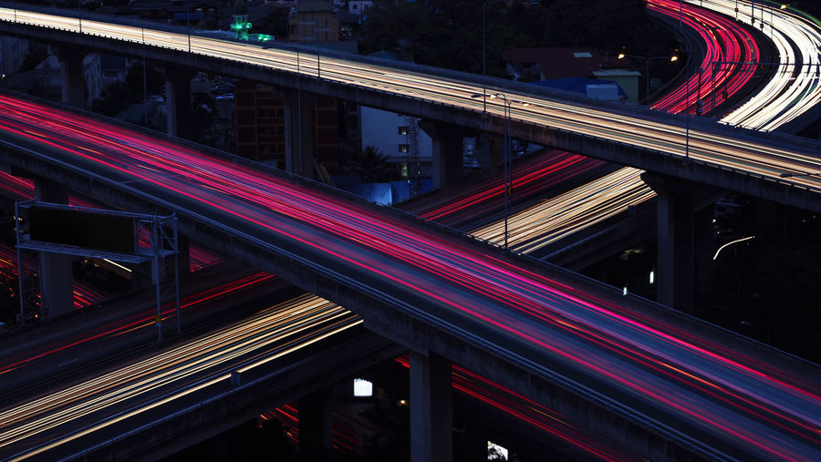 Motion blur of car light in city highway at dawn. cross intersection of urban highways.