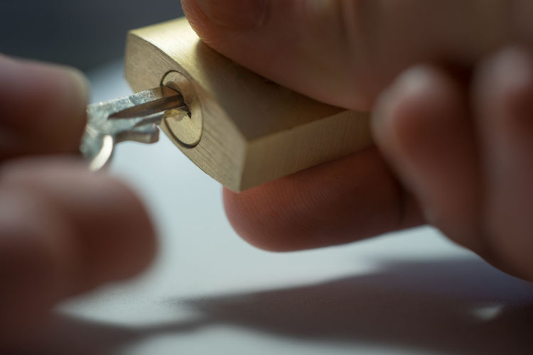 Cropped Hands Holding Lock And Key