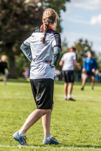 Full length rear view of woman on playing field