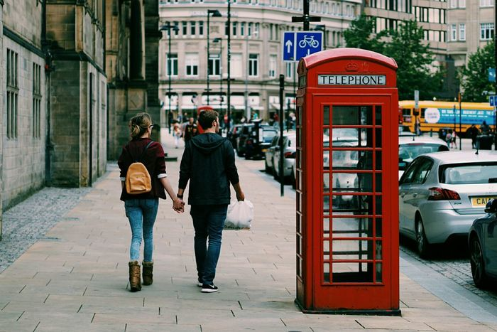 A couple in the street. Street Photography Couple Red Phone Boxes The Street Photographer - 2015 EyeEm Awards