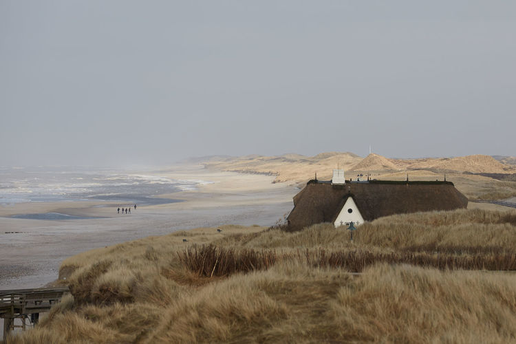 Sky Land Sea Architecture Built Structure Scenics - Nature Grass Building Exterior Plant Water Nature Horizon No People Beach Copy Space Day Landscape Beauty In Nature Building Horizon Over Water Outdoors Marram Grass Sylt Sylt, Germany