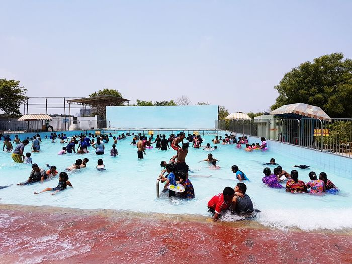 Large Group Of People Water Swimming Pool People Leisure Activity Sport Crowd Day Outdoors Adult Sky Ice Rink Men Adults Only Ice Hockey Live For The Story