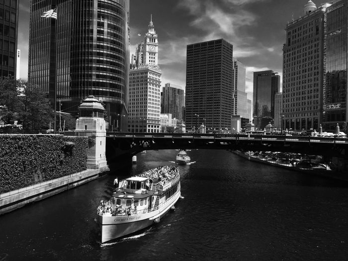 Architecture Bridge Bridge - Man Made Structure Building Building Exterior Built Structure City Cityscape Connection Financial District  Mode Of Transportation Modern Nature Nautical Vessel No People Office Building Exterior Outdoors Passenger Craft River Sky Skyscraper Tall - High Transportation Water Waterfront