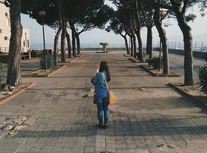 Full length of girl walking on footpath in park