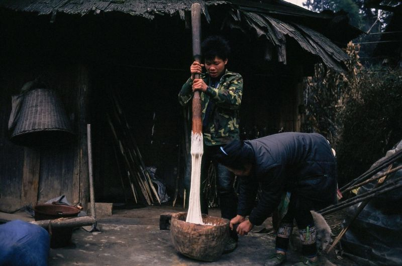 Side view of a man working on building