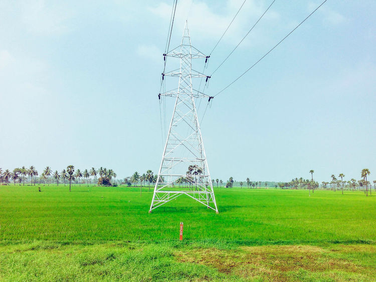 Grass Green Color Field Nature Sky Flying No People Outdoors Technology Transmission Line Tower Transmission Of Electricity Electricity  Electricity Tower EyeEm Selects EyeEmNewHere