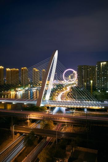 Iron Chain Flyover Ferris Wheel Gr3 男仔很忙 Building Exterior Illuminated Night Architecture City Built Structure Sky Cityscape Water Office Building Exterior Nature Building No People Skyscraper Transportation City Life Light Modern Outdoors Tall - High