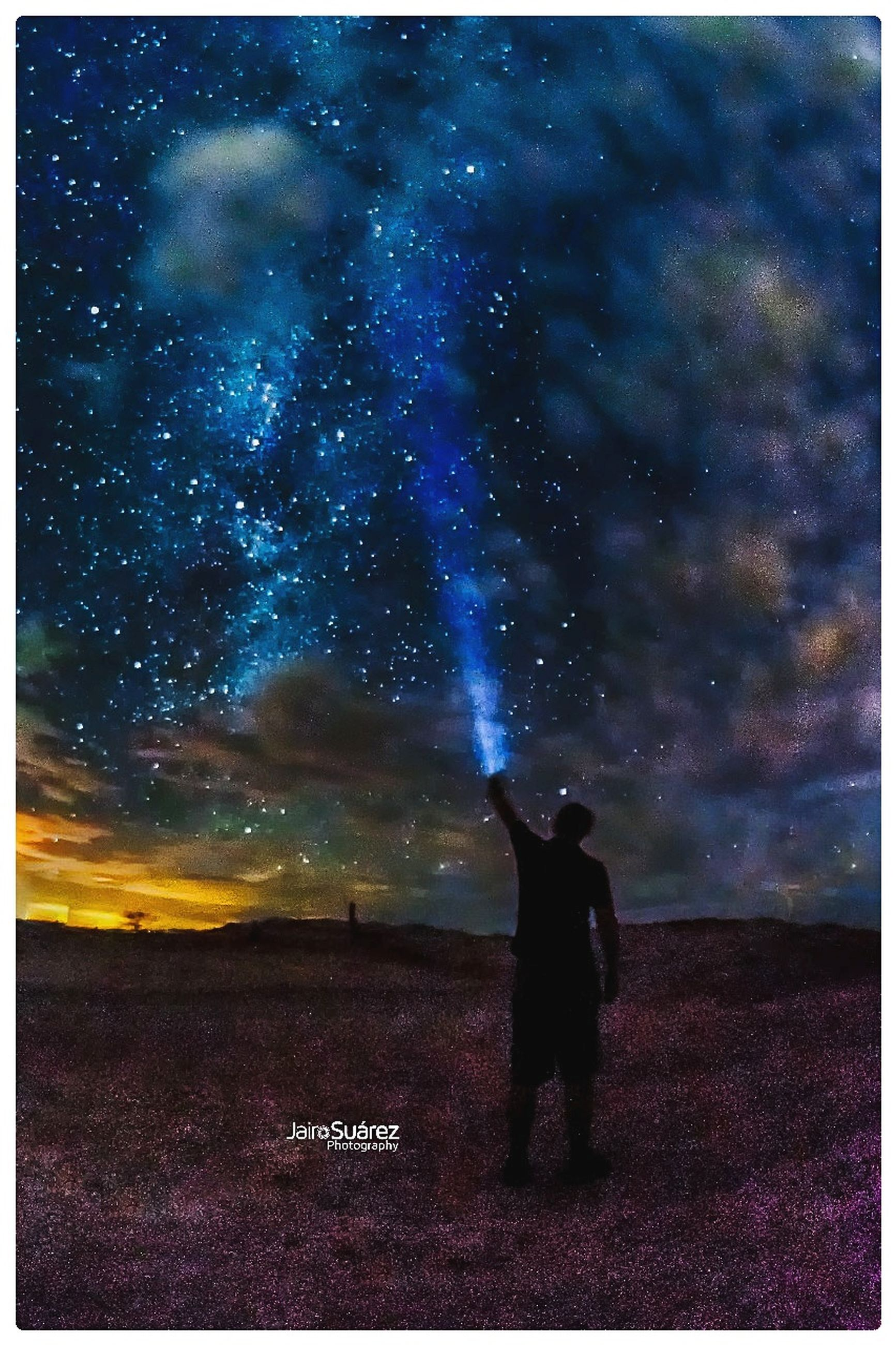 auto post production filter, night, transfer print, sky, silhouette, real people, one person, standing, star - space, cloud - sky, nature, field, land, men, outdoors, space, full length, human arm, lifestyles, purple, arms raised