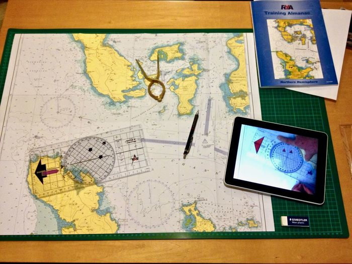 RYA Training Day Skipper Learning Plotting Portland Plotter Royal Yachting Association Tablet YachtMaster Chart Compass Compasses Digital Tablet Direction Dividers Exploration Guidance Indoors  Ipad Map Navigation Navigational Equipment Sailing Technology Theory Training Travel