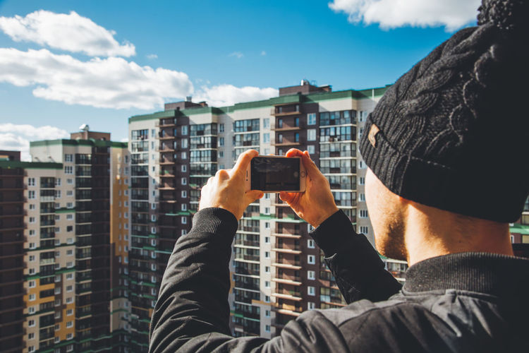 Photographing a photographer Activity Architecture Building Exterior Built Structure Cloud - Sky Communication Digital Camera Holding IPhone Leisure Activity Lifestyles Men Nature One Person Outdoors Photographing Photography Themes Real People Sky Smart Phone Technology Wireless Technology
