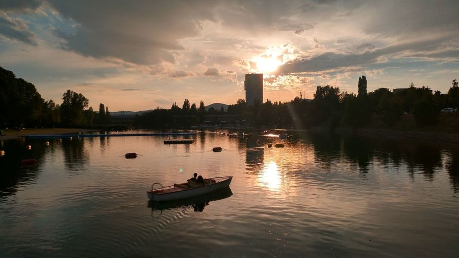 Lovers at Sunset Reflection Sunset Night Water River Sky Silhouette Outdoors Nautical Vessel Nature Street Photography City Life Donau Lovers Boot Love Travel Destinations