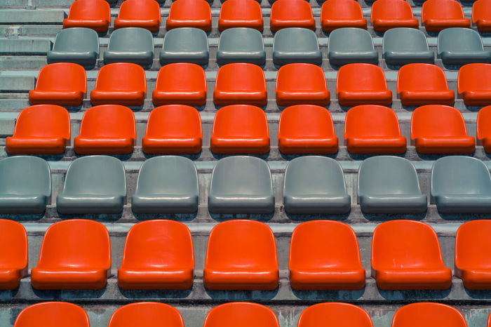 watch the game Auditorium Backgrounds Bleachers Chair Competition Day Empty Film In A Row Indoors  Lecture Hall Loneliness Modern Neat No People Red Repetition Seat Seminar Solitude Sparse Stadium Stage - Performance Space Standing Out From The Crowd Yellow EyeEm Diversity