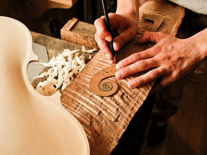 Adult Adults Only Art And Craft Carving - Craft Activity Close-up Craftsperson Day Holding Human Body Part Human Hand Indoors  Instrument Maker Men Midsection Musical Instrument Occupation One Man Only One Person Preparation  Real People Skill  Table Wood - Material Working Workshop