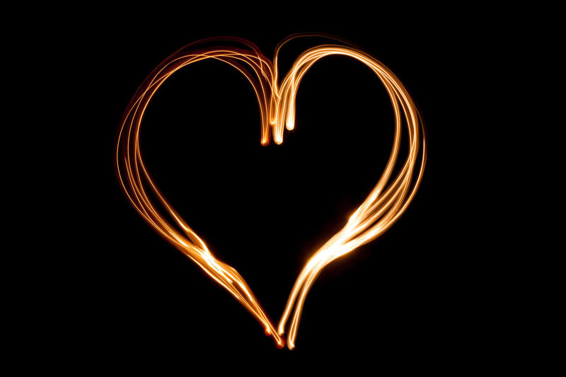 Close-up of illuminated heart shape against black background